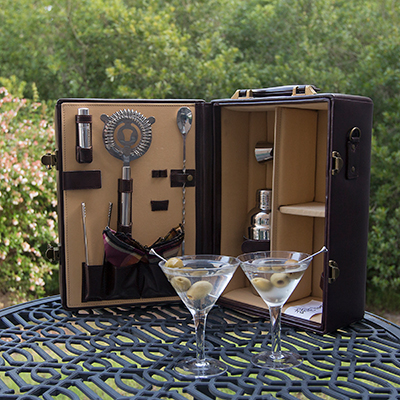 PICNIC TIME<sup>®</sup> Manhattan Portable Cocktail Case - Everything you need for a cocktail party on the go!  Leatherette case with velveteen lining holds 2 martini glasses, 2 cloth napkins, and several stainless steel bar tools including a double-sided jigger, ice tongs, a strainer and olive picks. Features heavy-duty suitcase-style case with handle and detachable shoulder strap.