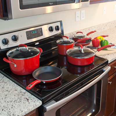 RACHAEL RAY™ Porcelain Enamel 10-pc Cookware Set - Red - Cook like a chef!  This set features red porcelain enamel on the outside with a non-stick interior, glass lids and silicon handles.  Oven safe to 400˚F.  Set includes 1.5-qt. Sauce Pan, 3-qt. Sauce Pan, 6-qt.  Stockpot, 2.75-qt. Sauté Pan, 8-in. French Skillet and 10-in. French Skillet.